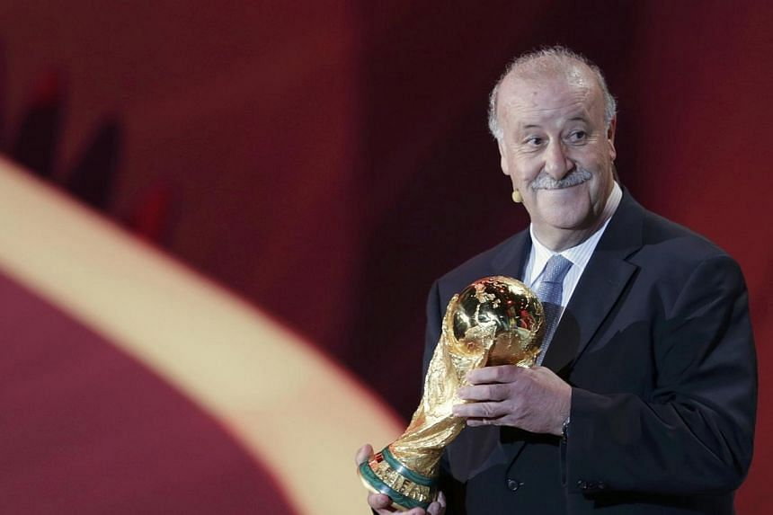 Spain's coach Vicente del Bosque holds the World Cup trophy at the draw for the 2014 World Cup at the Costa do Sauipe resort in Sao Joao da Mata, Bahia state, Dec 6, 2013. Vicente del Bosque's principle concern going into next year's World Cup f