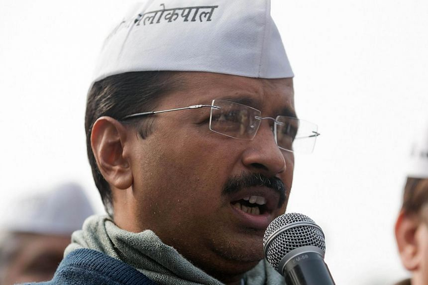 This file photo taken on December 23, 2013 shows Aam Admi Party (AAP) leader Arvind Kejriwal addressing a press conference at the party headquarters in Ghaziabad, some 20km east of New Delhi. -- PHOTO: AFP