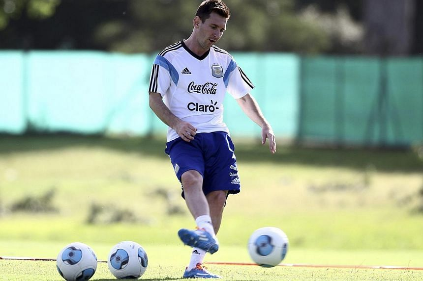 Argentine striker Lionel Messi kicks a ball during a training session at the squad's headquarters in this handout photo provided by the Argentine Soccer Association (AFA) in Buenos Aires on Dec 5, 2013. Messi is hoping for an injury free 2014 as his