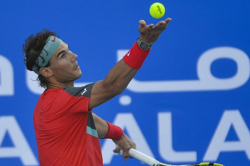 Spain's Rafael Nadal serves the ball to his compatriot David Ferrer during their semi final match on the second day of the Mubadala World Tennis Championship in the Emirati capital Abu Dhabi on Dec 27, 2013. Nadal has had new treatment on his trouble