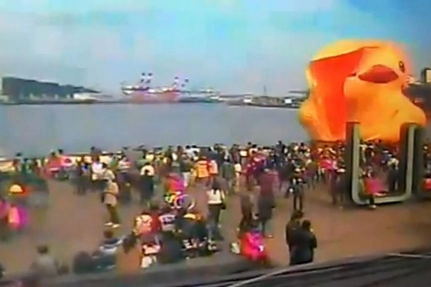A giant yellow duck on display in a northern Taiwan port exploded on Tuesday, Dec 31, 2013, just hours before it was expected to attract a big crowd to count down the new year. -- PHOTO: YOUTUBE SCREENGRAB