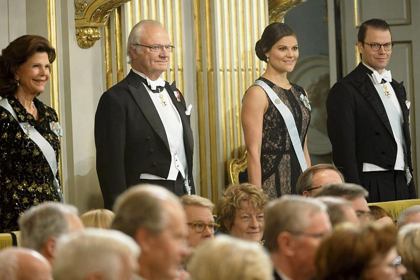(Left to right) Sweden's Queen Silvia, King Carl XVI Gustaf, Crown Princess Victoria and Prince Daniel attend the annual meeting of the Swedish Academy in the Old Town of Stockholm on Dec 20, 2013. Crown Princess Victoria fell over while skiing