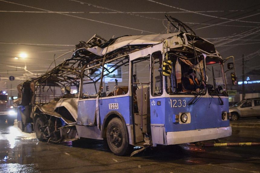 A bus, destroyed in an earlier explosion, is towed away in Volgograd on Dec 30, 2013. At least 14 people were killed on Monday when a suicide bomber blew himself up on a packed trolleybus in Volgograd, raising new concerns about security at the
