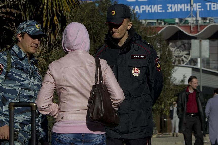 Russian police check a passerby in Sochi on Dec 30, 2013. The United States (US) government is concerned Islamist militants may be preparing attacks aimed at disrupting the Winter Olympic games in Sochi in February and has offered closer coopera