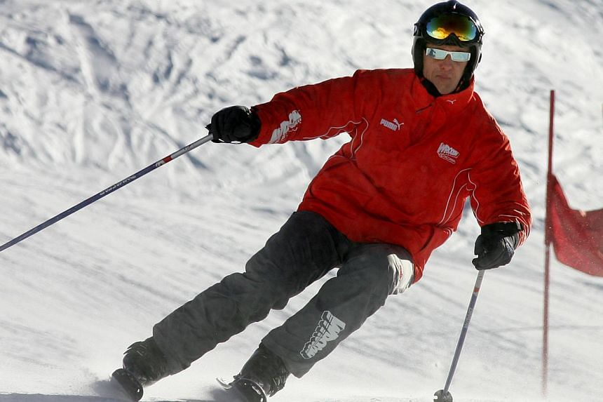 In this file photo dated Jan 14, 2005 shows German former Formula One driver Michael Schumacher skiing in the northern Italian resort of Madonna di Campiglio. Michael Schumacher, the greatest champion in the history of Formula One, was in a coma