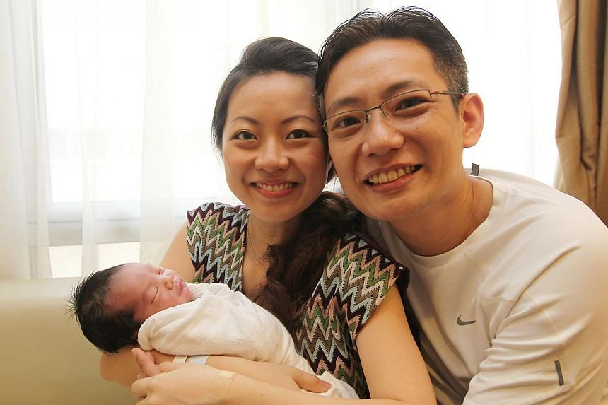 Singapore's first baby of 2014, Averett Sim, with his parents Jacqueline Tan and Dr Adrian Sim. -- ST PHOTO: SEAH KWANG PENG
