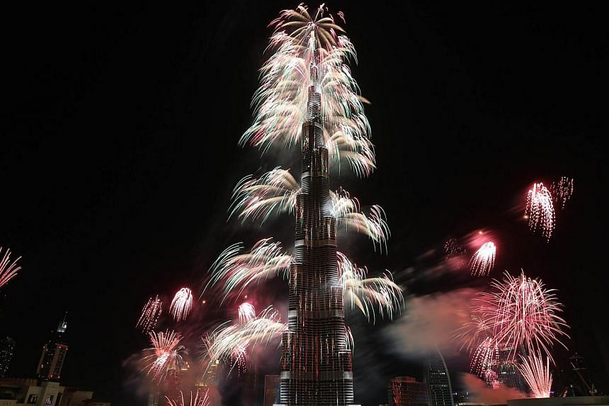 Fireworks explode from the Burj Khalifa, the world's tallest tower, in Dubai on Jan 1, 2014 to celebrate the new year. Dubai kicked off New Year with a dazzling bid for a new world record to cap those the Gulf city state already holds for its mammoth