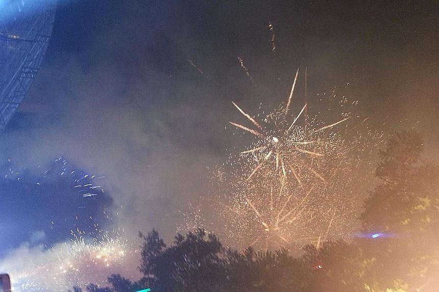 Colourful fireworks lit up the sky as some 20,000 revellers welcomed 2014 at Boon Lay town. -- ST PHOTO: AUDREY TAN
