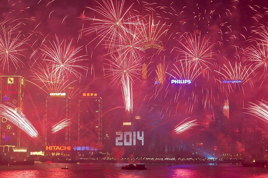 Fireworks explode over Victoria Harbour in Hong Kong on Jan 1, 2014. The Year of 2014 hit Hong Kong with a bang on Tuesday night with HK$13 million (S$2.13 million) worth of explosives fired off in a massive fireworks display above Victoria Harbour,