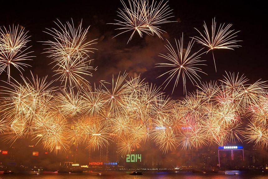 Fireworks explode over Victoria Harbour in Hong Kong on Jan 1, 2014. -- PHOTO: AFP