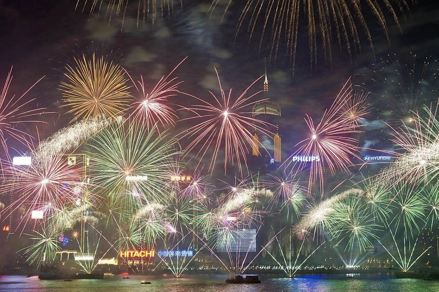Fireworks explode over Victoria Harbour in Hong Kong on Jan 1, 2014. -- PHOTO: AFP