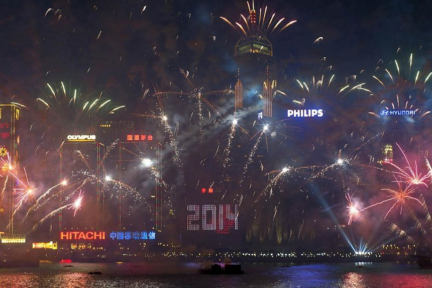 Fireworks explode over Victoria Harbour in Hong Kong on Jan 1, 2014. Tens of thousands of people will rally in Hong Kong on Wednesday to call for universal suffrage, as the city grapples with how its future leaders will be chosen under a long-awaited