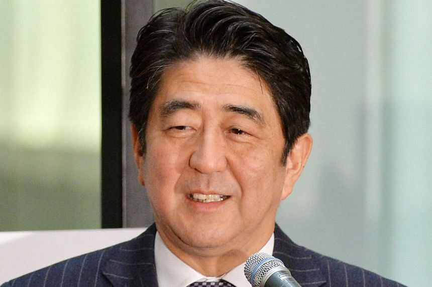 Japan's nationalist Prime Minister Shinzo Abe has said the country's pacifist post-World War II Constitution which limits its military to self-defence could be amended by 2020. -- PHOTO: AFP