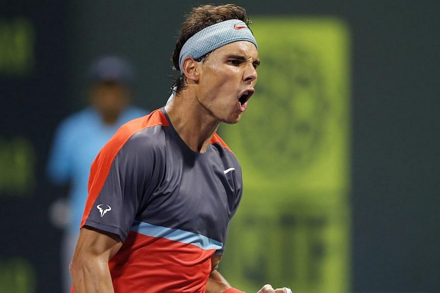 Rafael Nadal of Spain reacts as he plays against Lukas Rosol of the Czech Republic during their Qatar Open tennis match in Doha on Dec 31, 2013. World number one Rafael Nadal celebrated the New Year with a long-awaited atonement and a resolution to w
