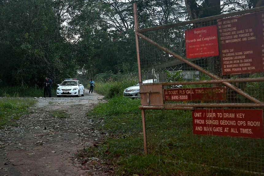 A body was found in a restricted area near Sungei Gedong camp, off Lim Chu Kang Rd, on Wednesday, Jan 1, 2014. -- ST PHOTO:KUA CHEE SIONG