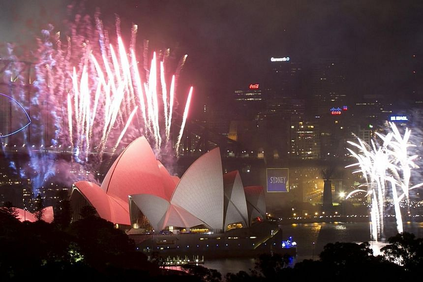 Fireworks explode over Sydney Harbour to usher in the new year, in Sydney, on Jan 1, 2014. -- PHOTO: REUTERS