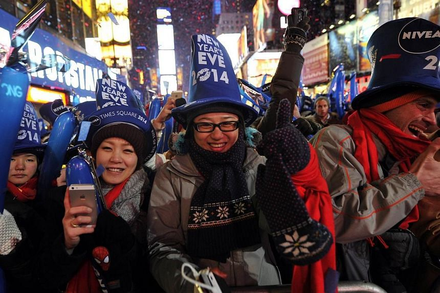 Thousands of revellers gather in New York's Times Square to celebrate the ball drop at the annual New Years Eve celebration, on Dec 31, 2013, in New York City. -- PHOTO: AFP