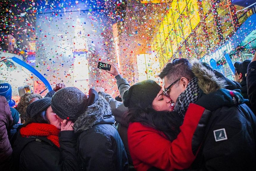 Couples kiss after midnight in Times Square during the New Years Eve celebration, on Jan 1, 2014, in New York City. -- PHOTO: AFP
