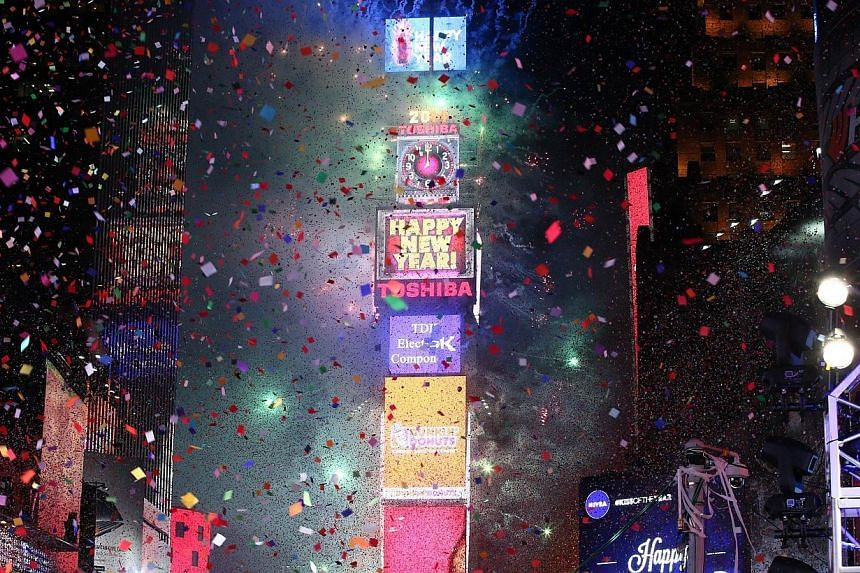 New York City rings in the new year with the ball dropping during The New Year's Eve 2014 Celebration in Times Square, on Dec 31, 2013, in New York City. Times Square erupted in joy and a shower of multi-colored confetti as New York City's famed glas
