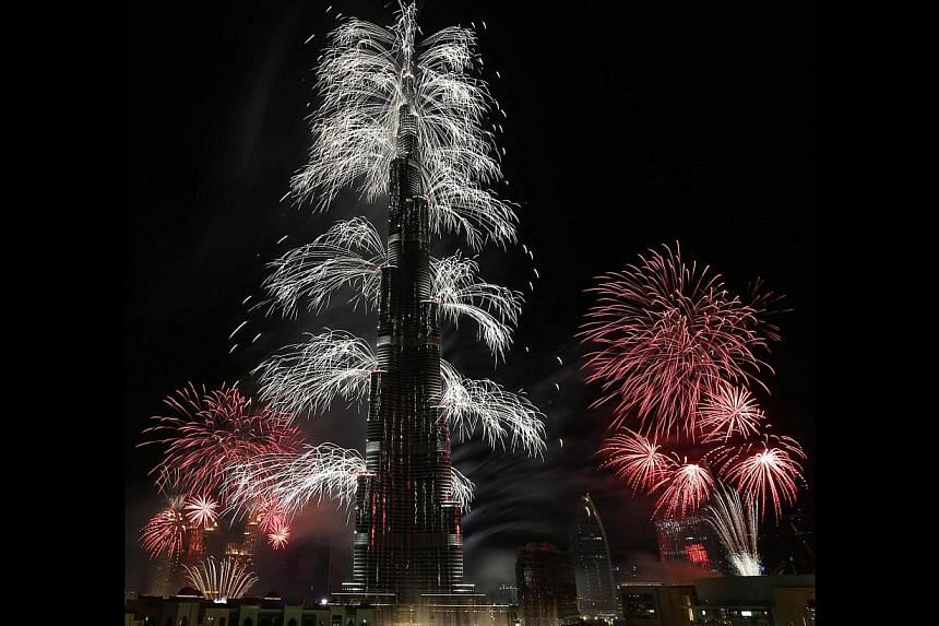 Fireworks explode from the Burj Khalifa, the world's tallest tower, in Dubai, on Jan 1, 2014, to celebrate the new year. -- PHOTO: AFP
