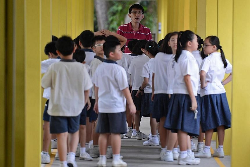 Minister Heng Swee Keat visits St Hilda's Primary School to welcome pupils on the first day of school. Mr Heng Swee Keat, in a Facebook post, had words of encouragement for parents with children starting school on Thursday.-- FILE PHOTO:R