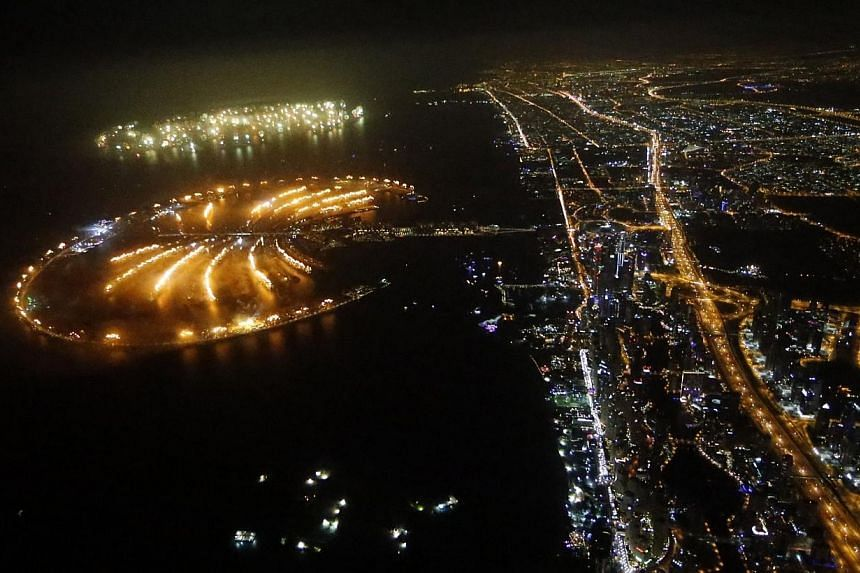 Fireworks explode over Palm Jumeirah in Dubai, on Jan 1, 2014, to celebrate the new year. -- PHOTO: AFP