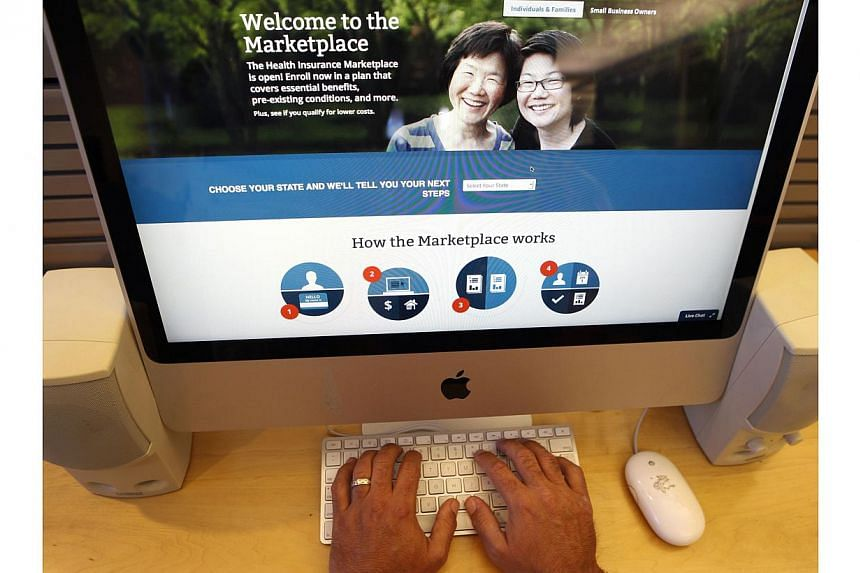 A man looks over the Affordable Care Act (commonly known as Obamacare) signup page on the HealthCare.gov website in New York in this Oct 2, 2013 photo illustration. More than 2 million people have signed up for private health insurance through Presid