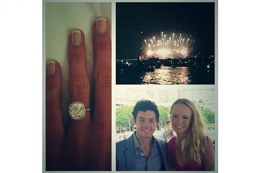 Two-time major golf champion Rory McIlroy and former women's tennis world number one Caroline Wozniacki announced their engagement on Wednesday in postings on Twitter.-- PHOTO: TWITTER OF RORY MCILROY