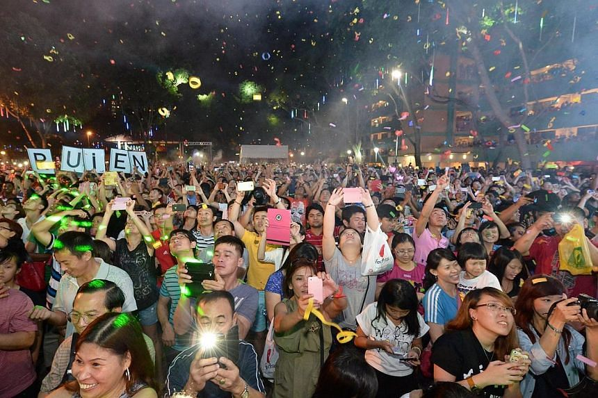 Party-goersatBoon Lay town'scountdownparty on Dec 31, 2013.-- ST PHOTO:NG SOR LUAN