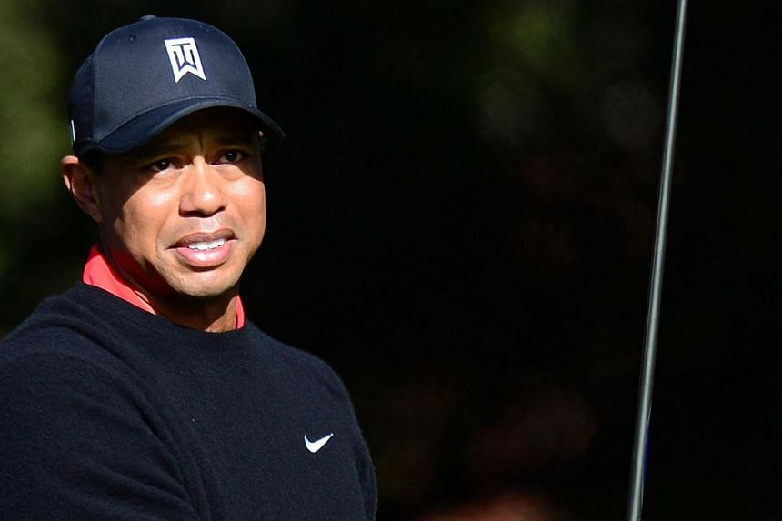 A week that began on Monday with the 38th birthday of world number one Tiger Woods will see the US PGA Tour's first 2014 event tee off without him on Friday in Hawaii. -- FILE PHOTO: AFP