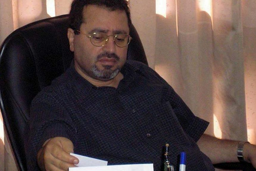 Palestinian ambassador to the Czech Republic Jamal al-Jamal sitting at a desk in an undisclosed location. Czech and Palestinian investigators were probing on Thursday, Jan 2, 2014, the mysterious death of the Palestinian envoy to Prague, who was