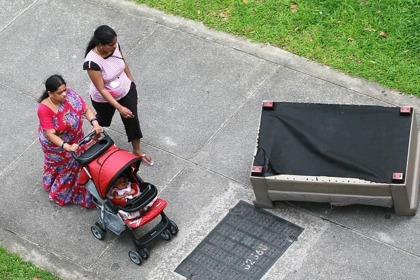 The two-seater sofa at the foot of Block 492 Jurong West Street 41. A woman passer-by called the police on New Year's Eve after she narrowly missed being hit by the sofa thrown from a fourth-floor flat.