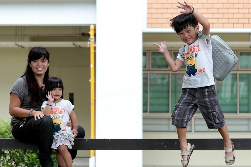 Five-year-old Eitan Leong with his mother Wong Li Wah, 36, and sister Emma, three. He is among some 250 children enrolled in five new kindergartens set up by the MOE in a move to raise pre-school standards in Singapore, and will attend the centre in