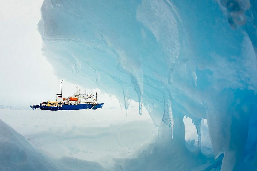 The MV Akademik Shokalskiy is pictured stranded in ice in Antarctica, on Dec 29, 2013. An attempt to rescue passengers from the stricken Russian ship is set to begin shortly, Australia's maritime authority said on Jan 2, 2013, after weather condition