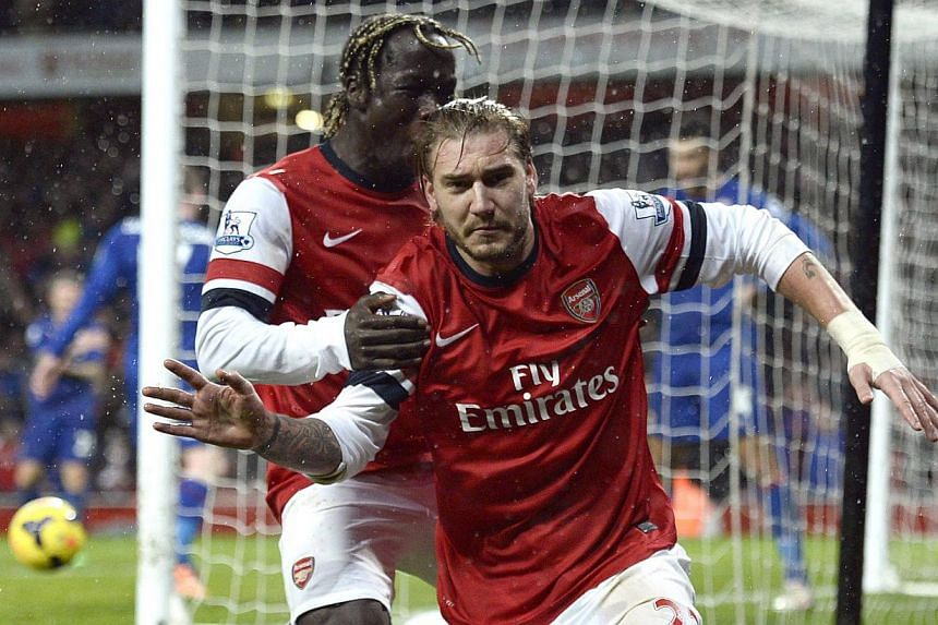 Arsenal's Nicklas Bendtner (right) celebrates his goal against Cardiff City with Bacary Sagna during their English Premier League match at the Emirates Stadium in London on Jan 1, 2014.Bendtner and Theo Walcott scored last-gasp goals as Arsenal