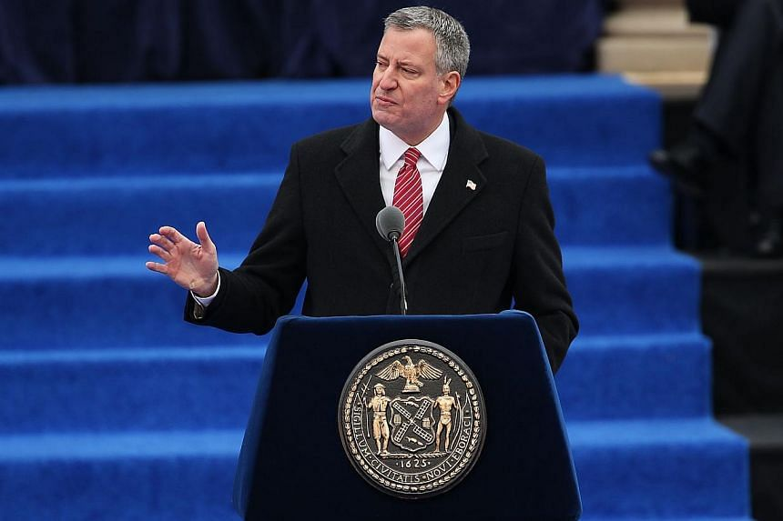 New York City's 109th Mayor Bill de Blasio speaking after his swearing-in as mayor at City Hall on Jan 1, 2014 in New York City.Mr de Blasio has promised to restore progressive ideals and end growing economic inequality in America's biggest cit