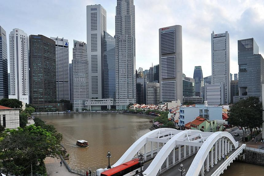 Singapore's economy grew 4.4 per cent in the final quarter of 2013 from a year ago, but expansion in key sectors moderated from the previous three months. -- ST FILE PHOTO: LIM YAOHUI