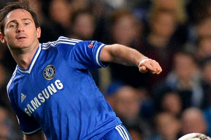Chelsea's English midfielder Frank Lampard passes the ball during the UEFA Champions League group E football match between Chelsea and Steaua Bucharest at Stamford Bridge on Dec 11, 2013. Chelsea midfielder Frank Lampard and defender Branislav Ivanov