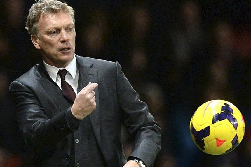 Manchester United manager David Moyes throwing the ball back onto the pitch during their English Premier League match against Tottenham Hotspur at Old Trafford on Jan 1, 2014. Moyes criticised referee Howard Webb for not giving his side a late penalt