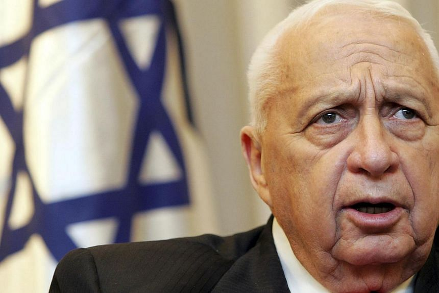 """Israeli Prime Minister Ariel Sharon attends a meeting with the Israeli president Moshe Katsav in Jerusalem on Feb 21, 2005. Mr Sharon, comatose since a 2006 stroke, has detriorated to a """"life threatening"""" condition after suffering kidney malfunct"""