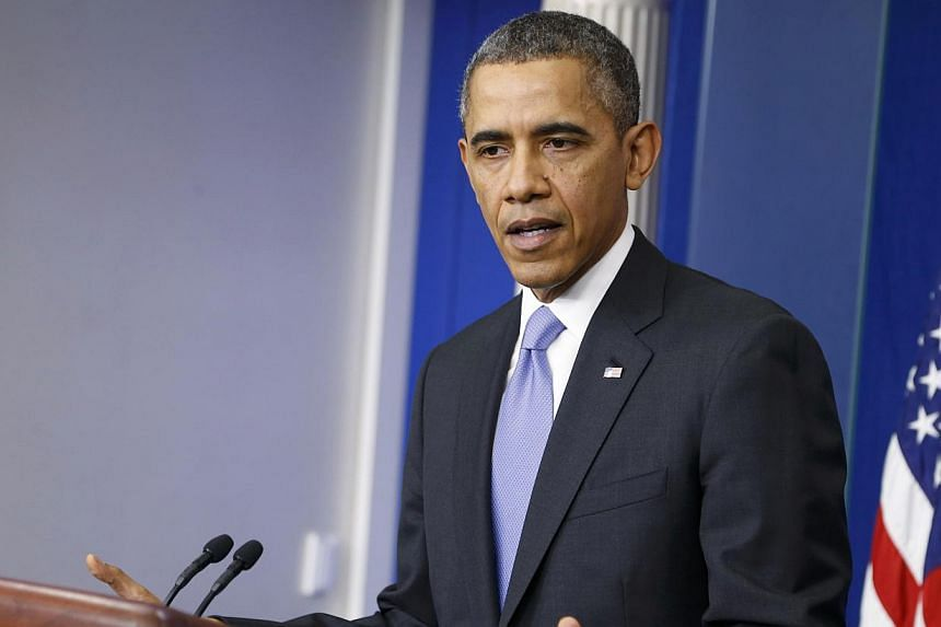 US President Barack Obama addresses his year-end news conference in the White House briefing room in Washington, on Dec 20, 2013. United States (US) President Barack Obama wished Mrs Barbara Bush well on Wednesday, saying he and his wife Michelle hop