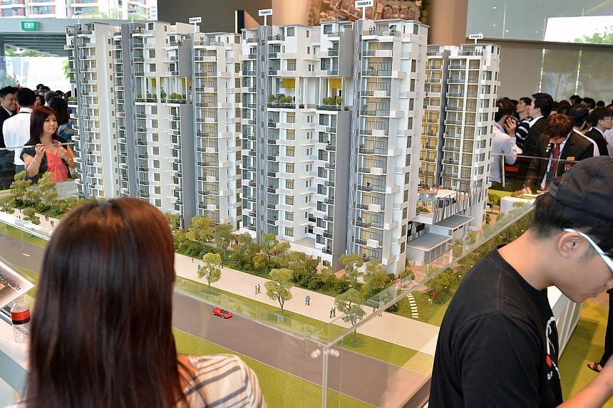 Potential buyers turn up at the launch of the Urban Vista, which is next to the Tanah Merah MRT station. Private home prices fell 0.8 per cent in the last quarter of 2013 from the previous quarter, according to Urban Redevelopment Authority flash est