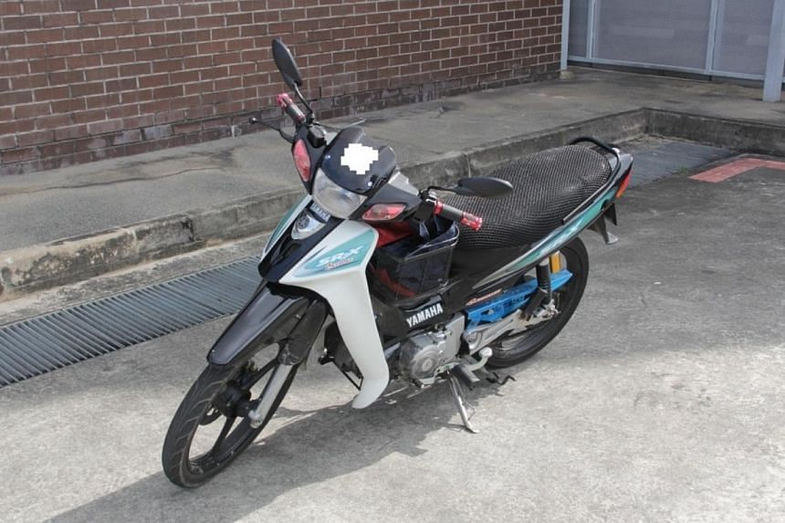 At 5.20am, officers from the Immigration & Checkpoints Authority referred a Malaysian man who was riding a motorcycle to CNB for checks.-- PHOTO:CENTRAL NARCOTICS BUREAU