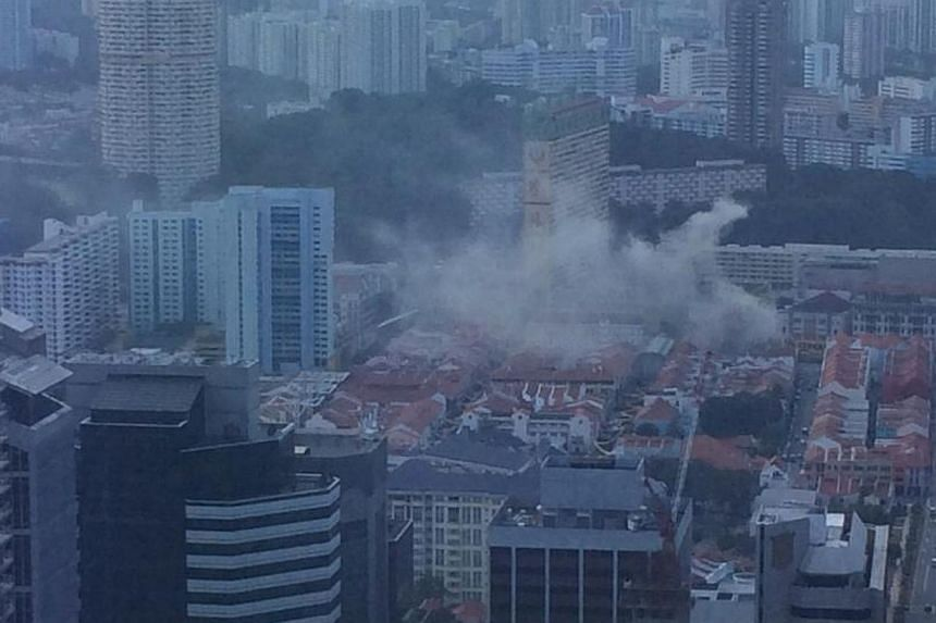 Plumes of smoke were seen above the Chinatown area on Thursday afternoon after a fire broke out in a side street.-- PHOTO: GERALD TEW CHONG HWEE