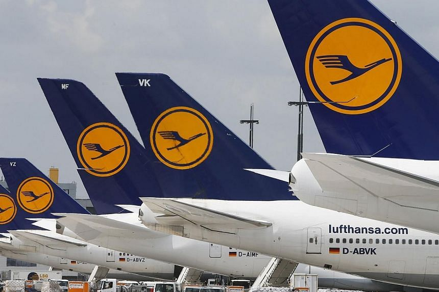 Lufthansa aircraft parked on the tarmac at Frankfurt airport on July 12, 2013.French unions have called on Lufthansa workers at Paris's Charles de Gaulle airport to strike from Friday morning to Sunday evening in a dispute over outsourcin