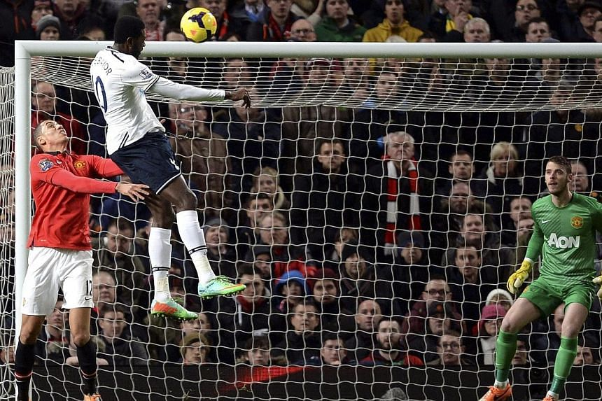 "Returning striker Emmanuel Adebayor (centre) was ""almost unstoppable"" after the Togolese scored the opening goal in a 2-1 win at Manchester United to continue Tottenham Hotspur's recent revival, manger Tim Sherwood said. -- PHOTO: REUTERS"