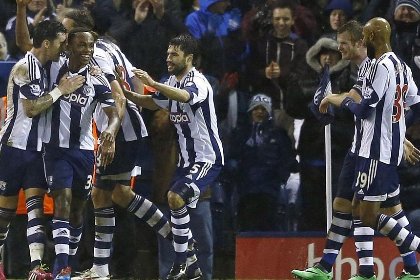West Bromwich Albion's Saido Berahino (second from left) celebrates scoring a penalty with teammates during their English Premier League match against Newcastle United at The Hawthorns on Jan 1, 2014. West Brom caretaker boss Keith Downing has u