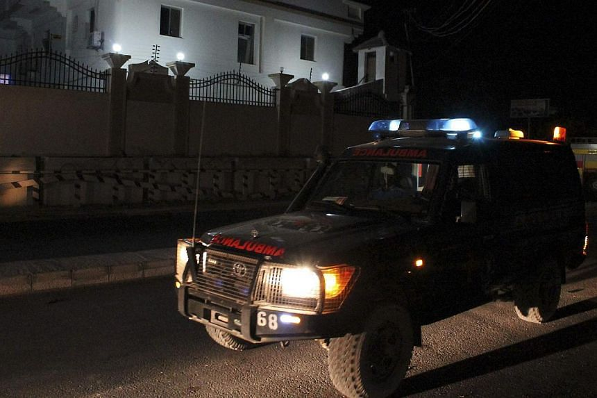 An ambulance arrives at the scene of an explosion outside the Jazira hotel in Mogadishu on Jan 1, 2014. Three bombs that exploded within an hour outside a hotel in the Somali capital of Mogadishu killed at least 11 people and the death toll was expec