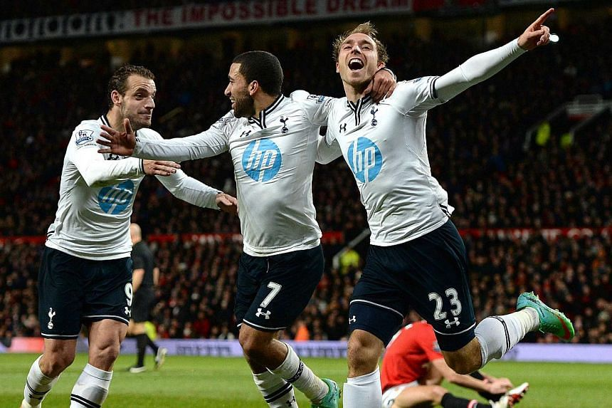 Tottenham Hotspur's Christian Eriksen (right) celebrating his goal against Manchester United with Aaron Lennon (centre) and Roberto Soldado during their English Premier League match at Old Trafford on Jan 1, 2014. Tottenham Hotspur beat Manchest