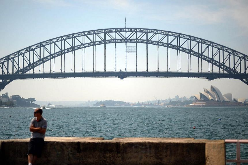 A view of Sydney Harbour is seen under a thin layer of smoke due to sporadic minor bushfire and back burning on Nov 8, 2013. Australia experienced its hottest year on record in 2013, the Bureau of Meteorology said on Friday, enduring the longest heat
